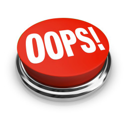 A big red button with the word Oops to press and get customer support or service or to fix or correct an error, mistake, problem or gaffe you have made